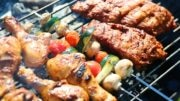 Assorted meat and vegetables on barbecue grill cooked for summer family dinner