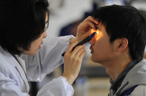 An examinee takes an ophthalmic test during a military pilot selection in Wuhan